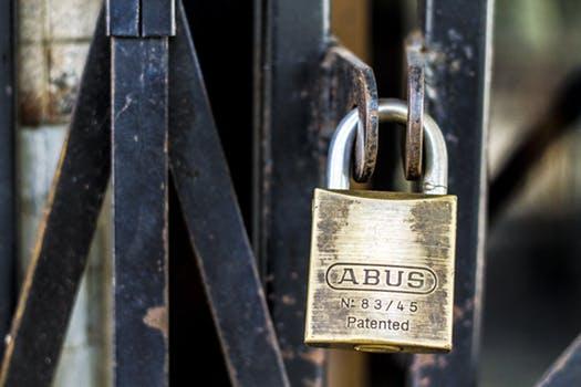 Locked_Brass_Lock_On_Metal_Fence